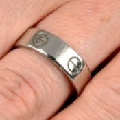 A platinum 'Love' ring, by Cartier.