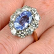 An 18ct gold Sri Lankan sapphire and brilliant-cut diamond cluster ring.With report 20012,