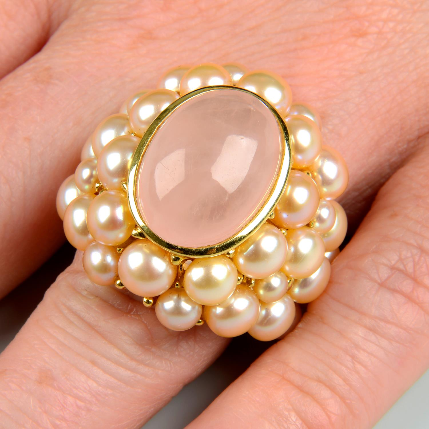 A rose quartz cabochon and pink cultured pearl cocktail ring, by Mimi.Signed Mimi.Stamped 750.