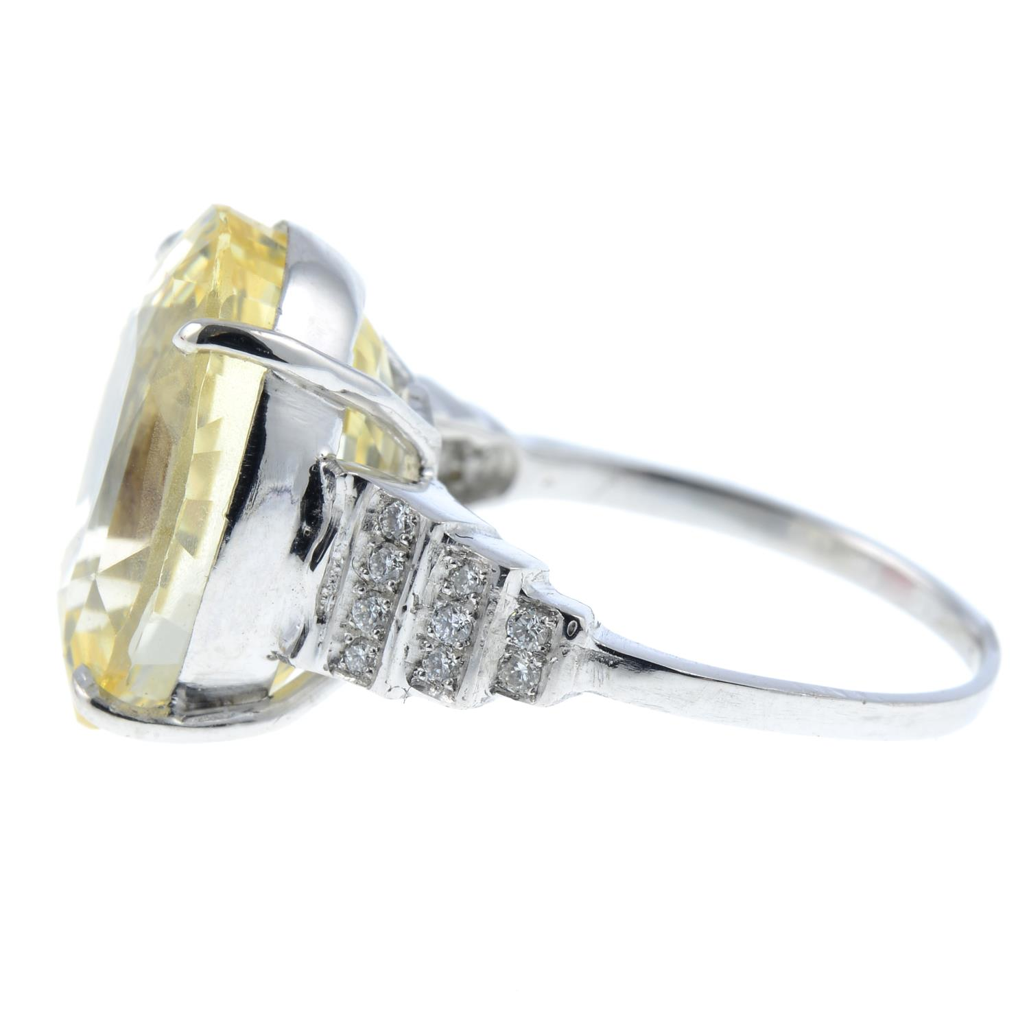 A yellow sapphire and diamond ring.Sapphire weight 15.31cts.Estimated total diamond weight 0.10ct, - Image 4 of 6