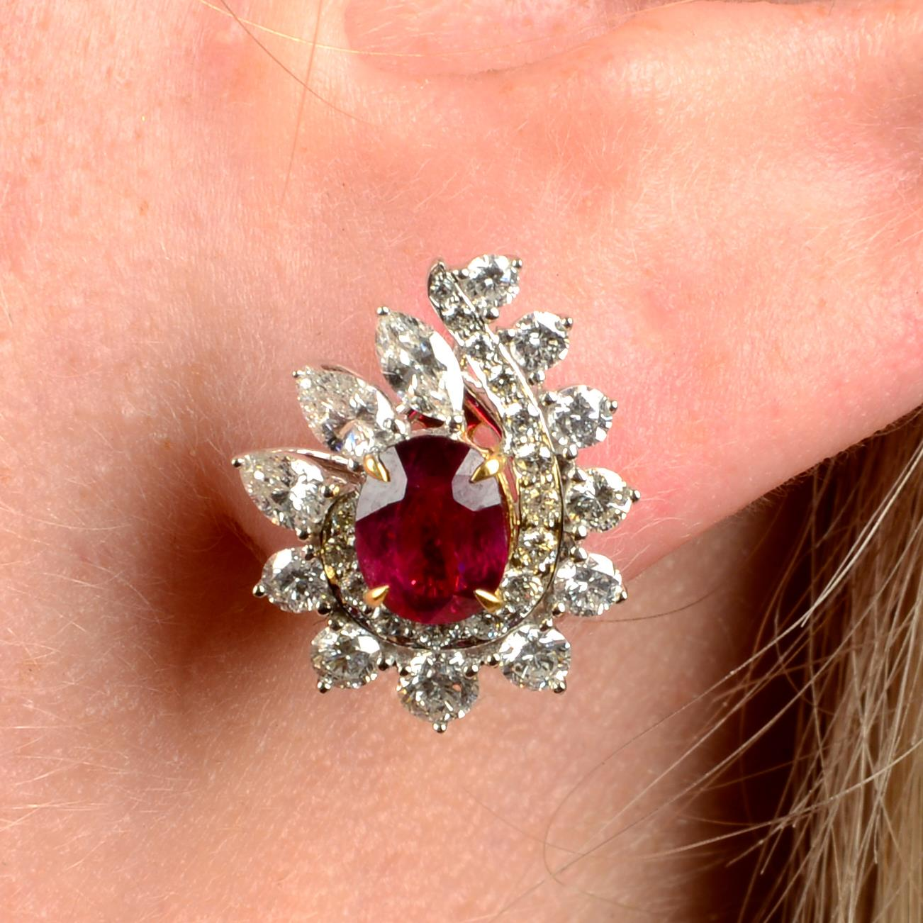 A pair of 'Pigeon's Blood' Burmese ruby and vari-cut diamond earrings.With reports from GRS,