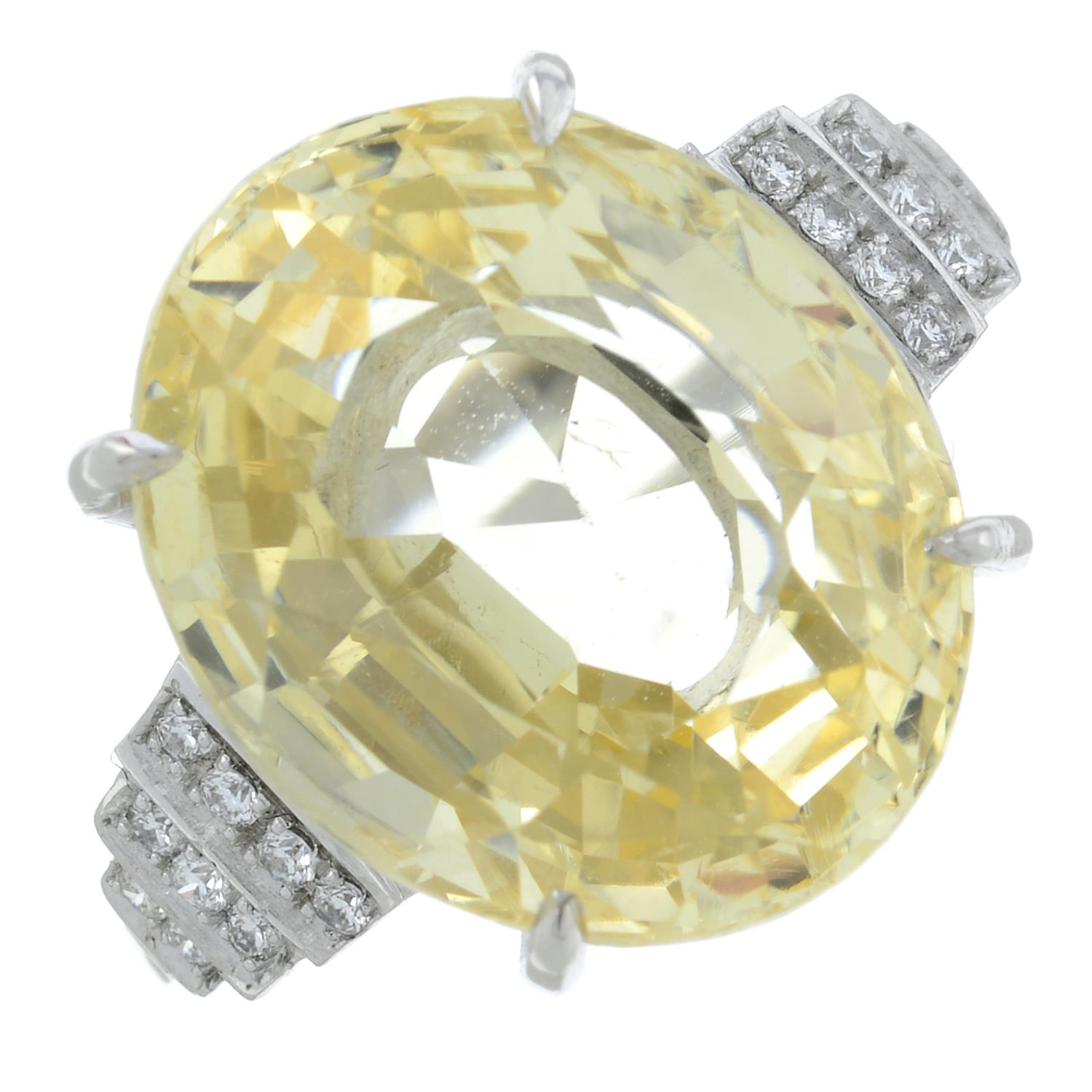 A yellow sapphire and diamond ring.Sapphire weight 15.31cts.Estimated total diamond weight 0.10ct, - Image 2 of 6