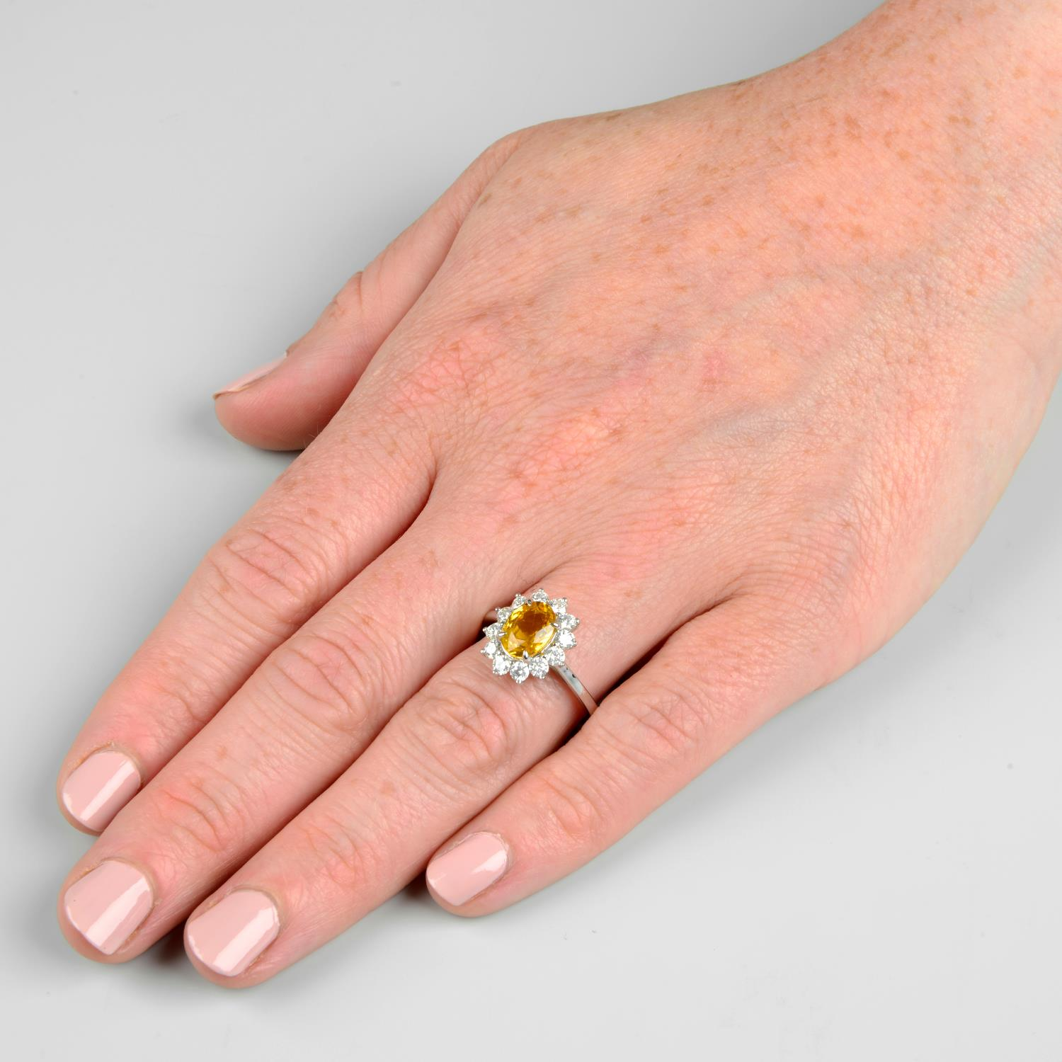 A yellow sapphire and brilliant-cut diamond cluster ring.Sapphire calculated weight 1.73cts, - Image 3 of 6