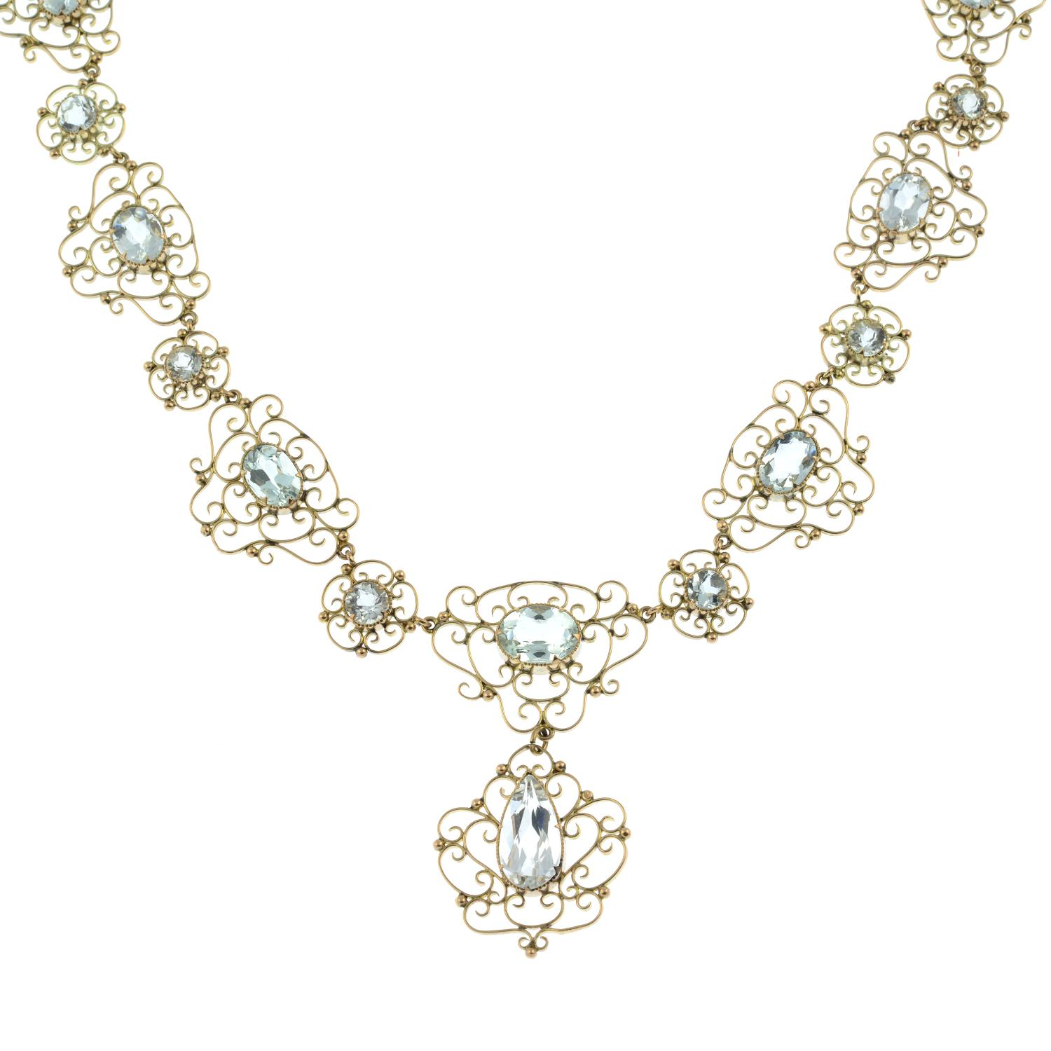 An early 20th century Arts & Crafts gold aquamarine necklace.Length 43.5cms. - Image 2 of 6