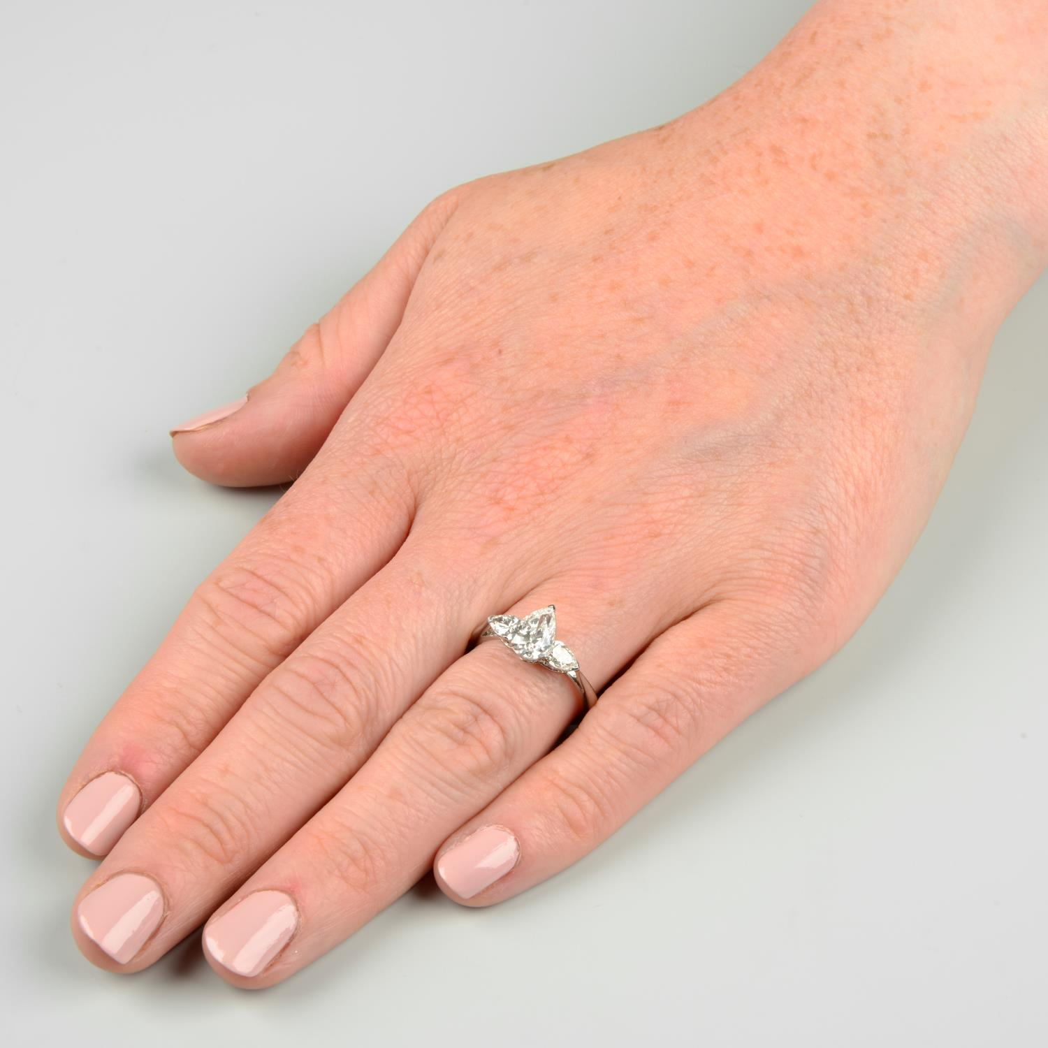 A pear-shape diamond three-stone ring.With report 1146953348, - Image 3 of 7