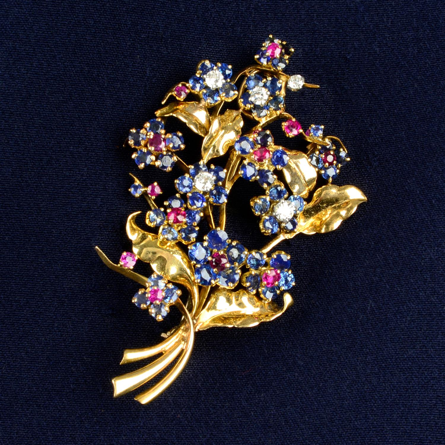 A mid 20th century 18ct gold sapphire, ruby and diamond floral brooch, by Mauboussin.
