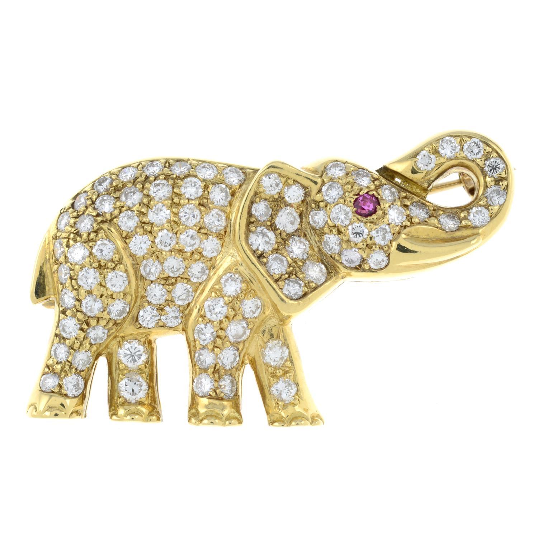 A pavé-set diamond elephant brooch, with ruby eye.Total diamond weight 1.70cts.Length 3.9cms. - Image 2 of 4