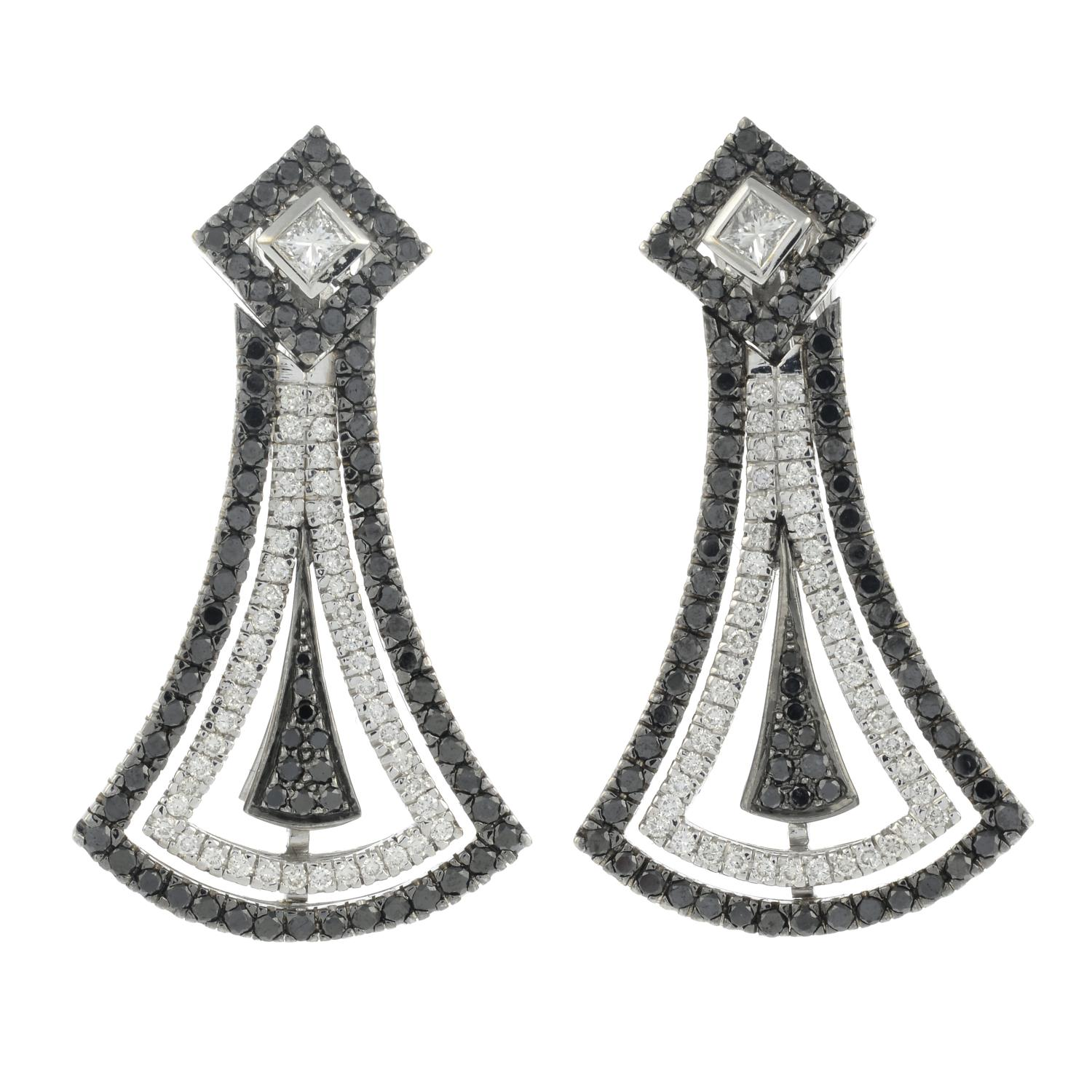 A pair of diamond and black gem earrings.Estimated total diamond weight 1.35cts, - Image 2 of 3