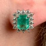 A pair of emerald and diamond cluster earrings.Emerald calculated total weight 3.16cts,