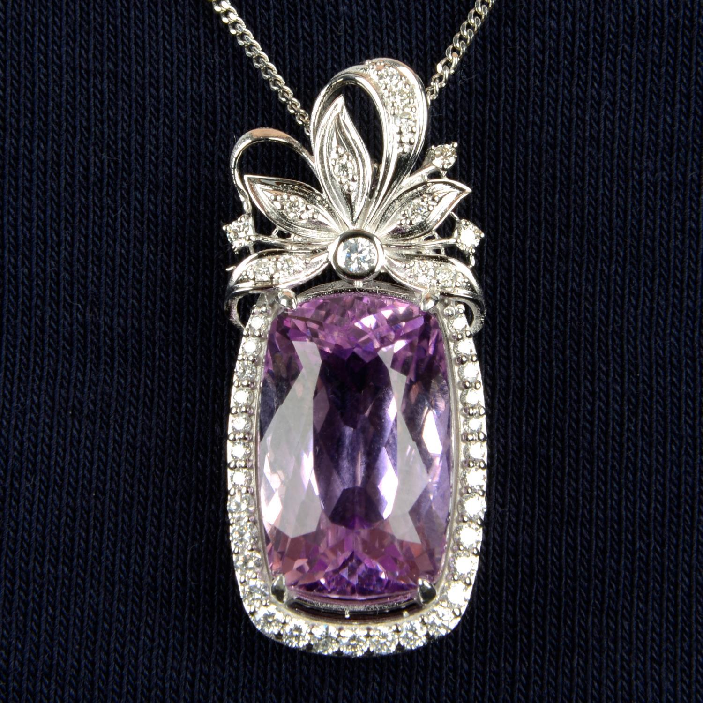 A kunzite and diamond floral pendant.