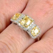 A 'yellow' diamond and diamond three-stone cluster ring.Estimated total 'yellow' diamond weight