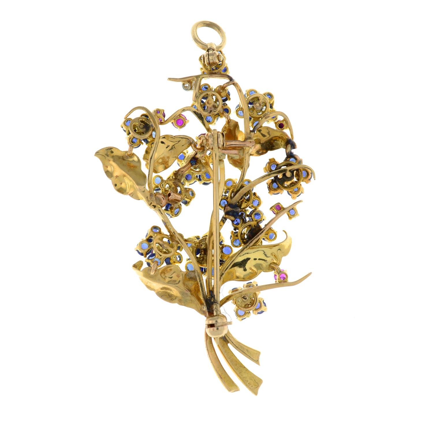A mid 20th century 18ct gold sapphire, ruby and diamond floral brooch, by Mauboussin. - Image 4 of 4