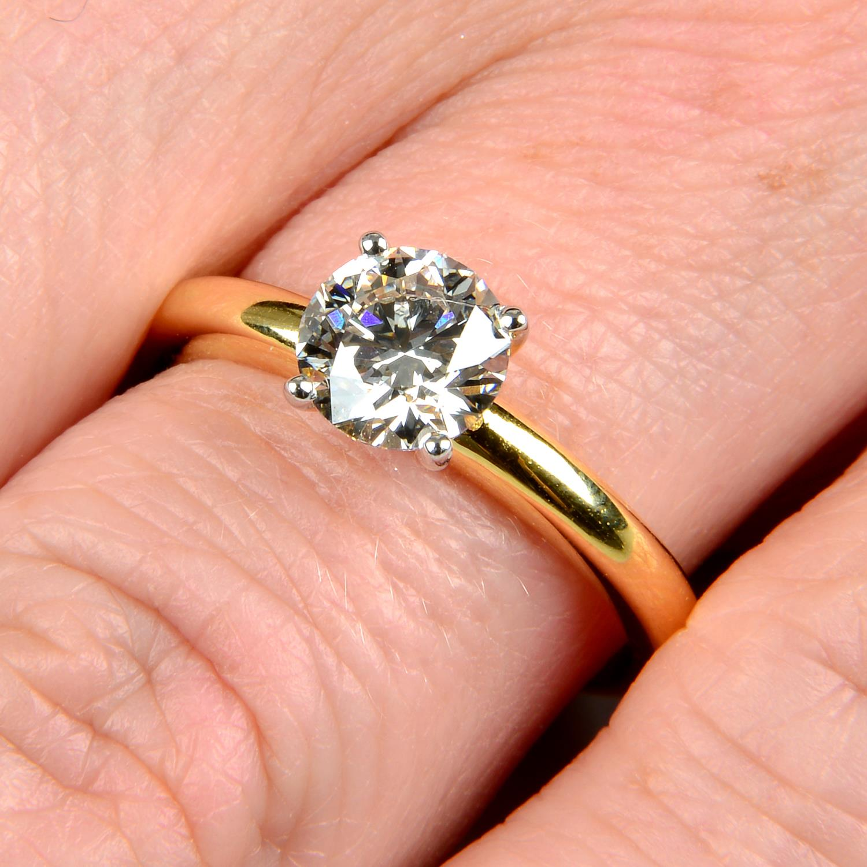 A brilliant-cut diamond single-stone ring.Diamond weight 1.01cts, estimated G+ colour, VS clarity.