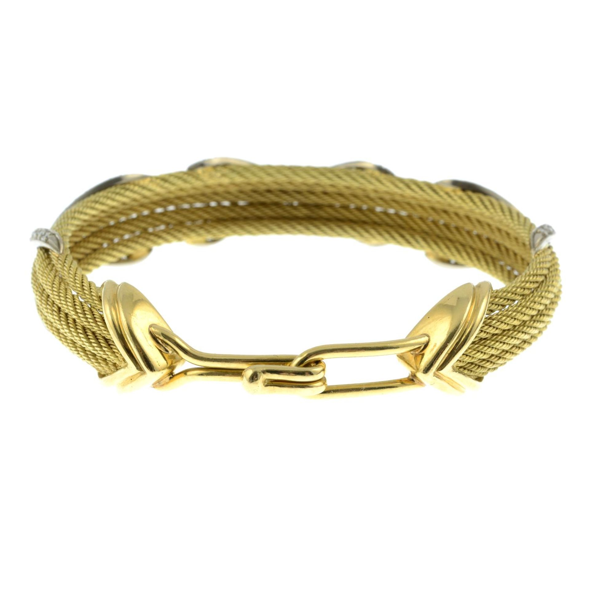 A rope-twist bangle, with pavé-set diamond cross highlights. - Image 3 of 3