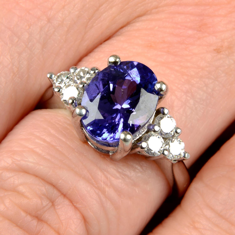 A tanzanite and diamond ring.Tanzanite calculated weight 2.72cts,