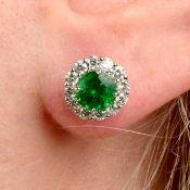 A pair of tsavorite garnet and brilliant-cut diamond cluster earrings.Estimated total diamond