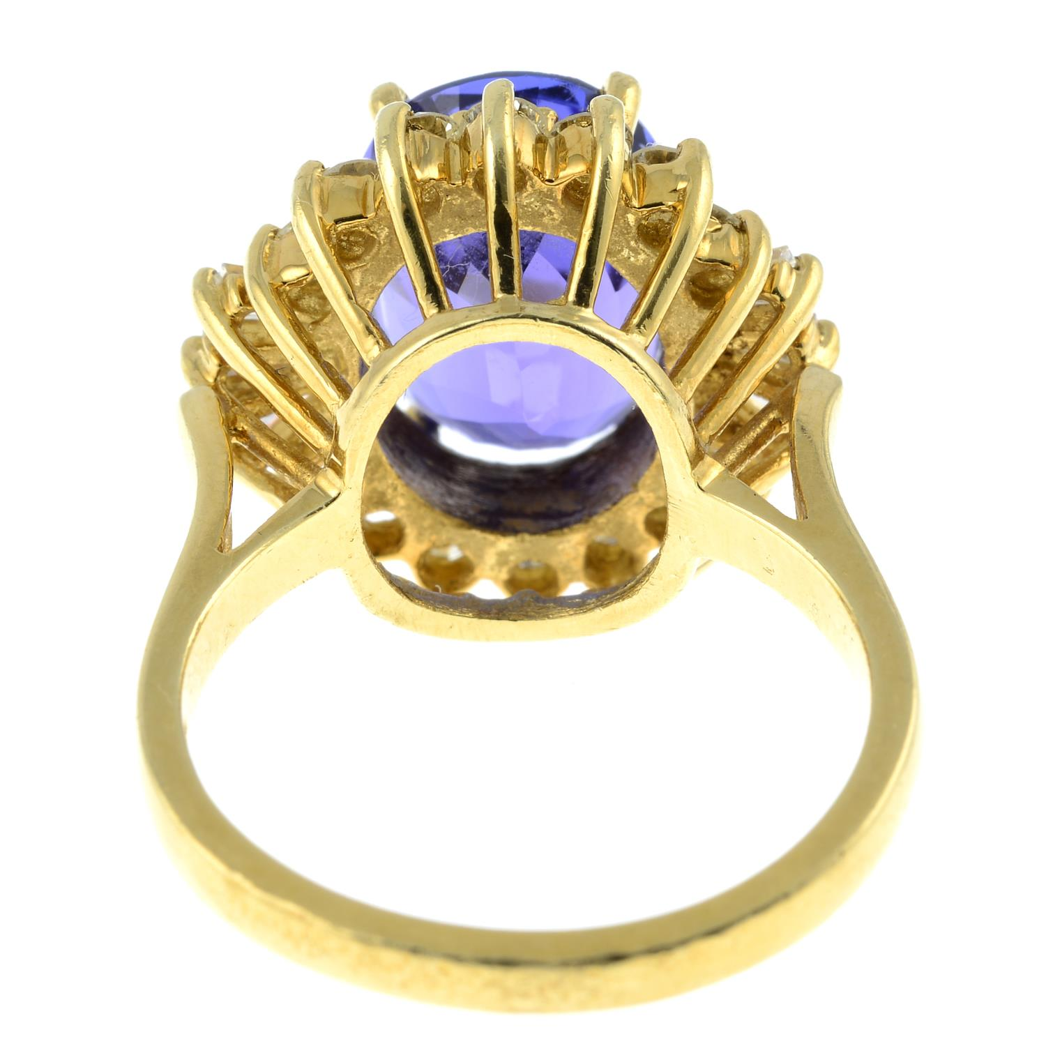 A tanzanite and vari-cut diamond cluster ring.Tanzanite calculated weight 5.41cts, - Image 5 of 6