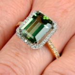 An 18ct gold green tourmaline and brilliant-cut diamond ring.Tourmaline weight 3.37cts.Total