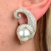 A pair of cultured pearl and pavé-set diamond scroll earrings.Estimated total diamond weight 4cts,