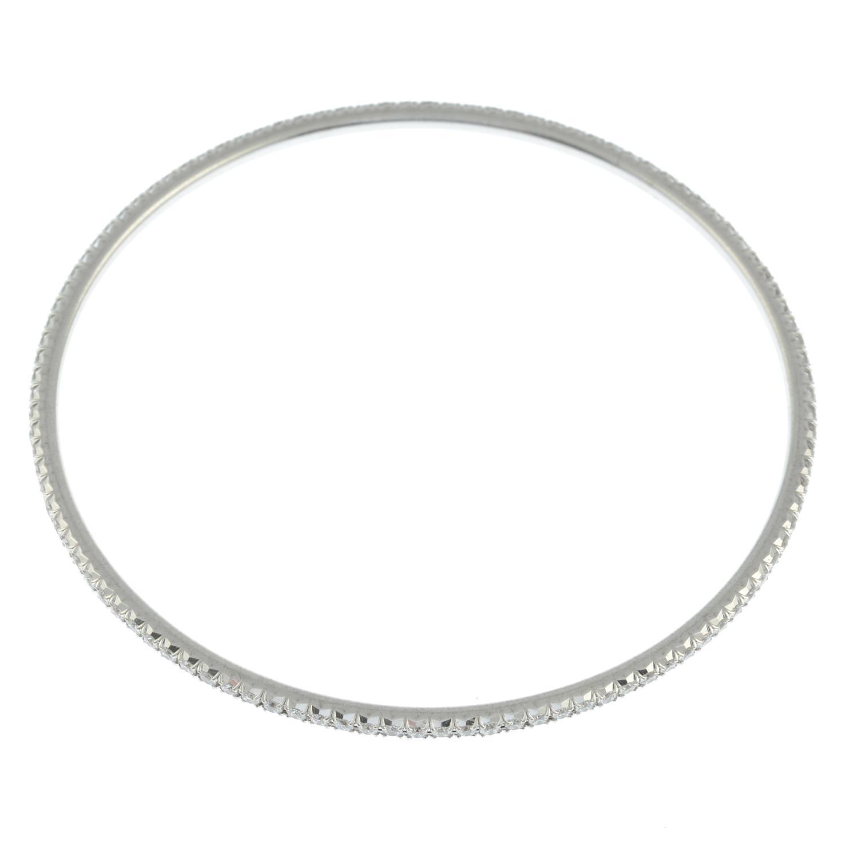 An 18ct gold brilliant-cut diamond 'Metro' bangle, - Image 3 of 3