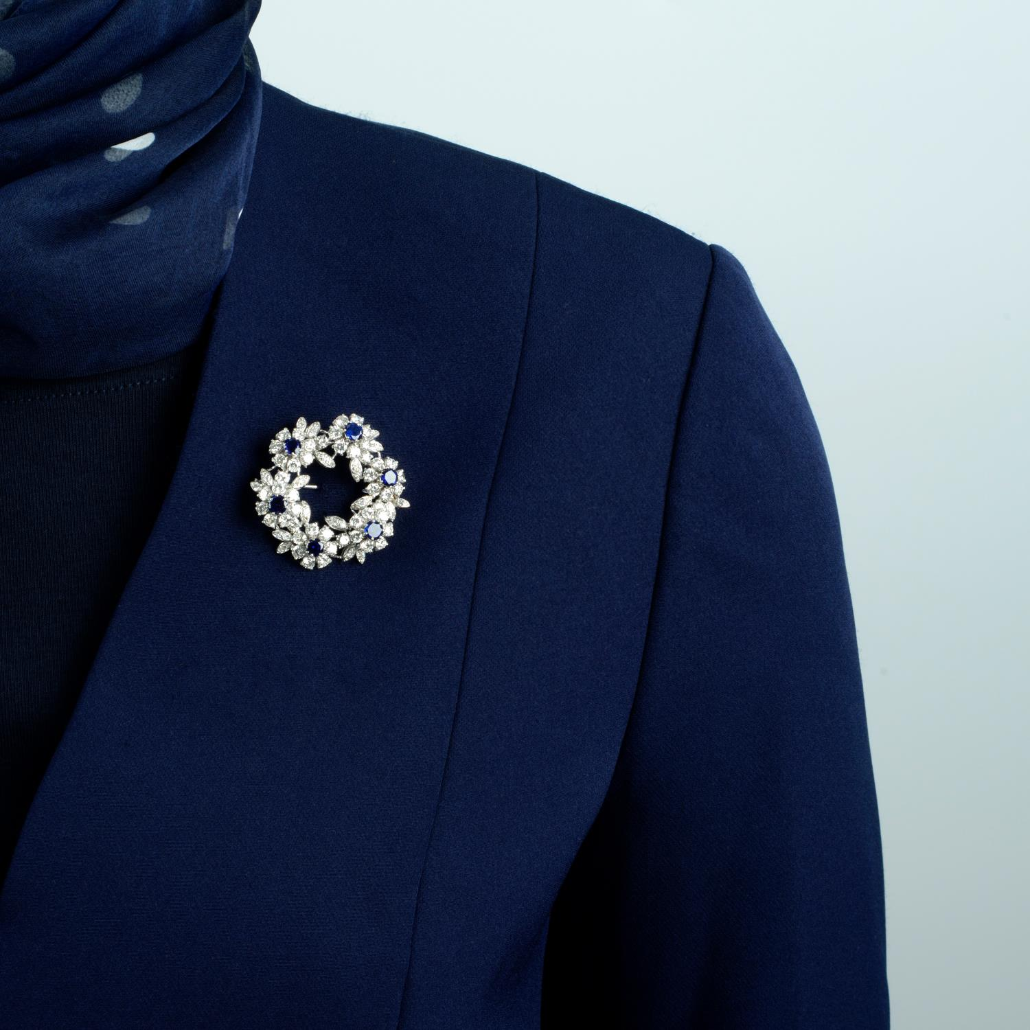 A mid 20th century 18ct gold sapphire and diamond floral wreath brooch.Estimated total sapphire - Image 3 of 4