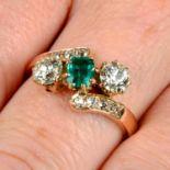 An emerald and circular-cut diamond three-stone ring,