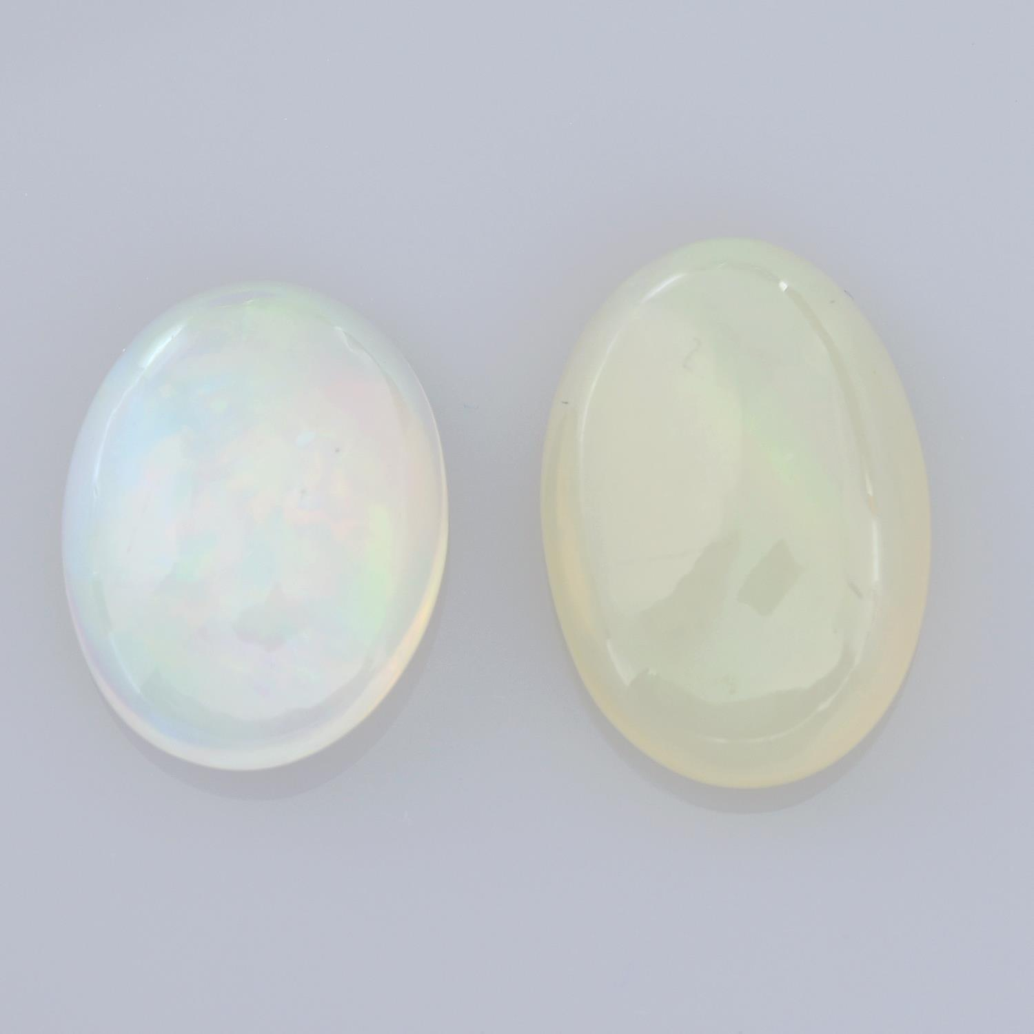 Two oval shape opals, weighing 12.25ct.