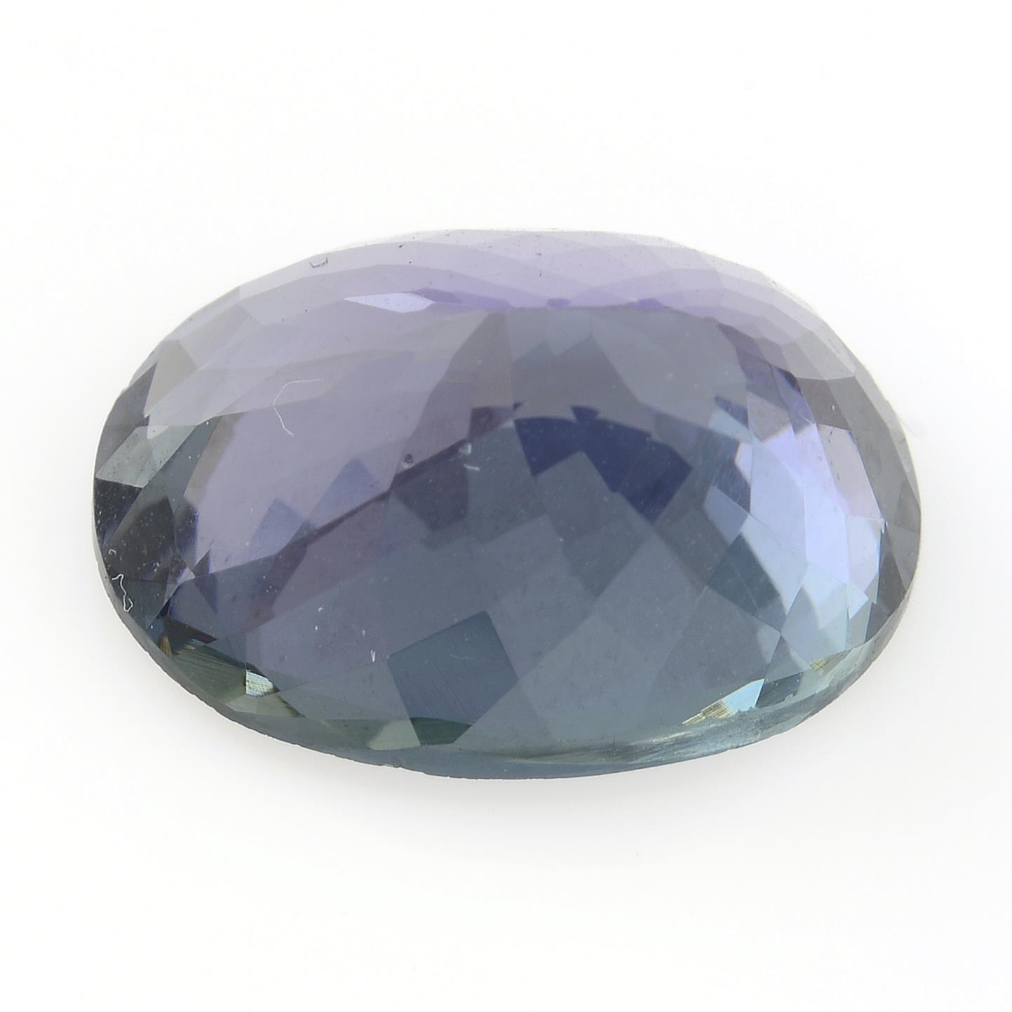An oval-shape tanzanite, weighing 5.66cts. - Image 2 of 4