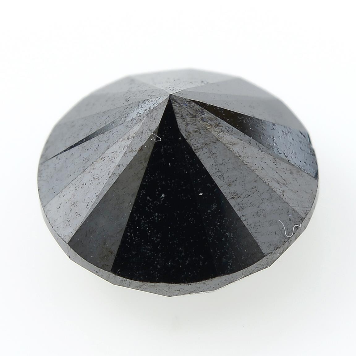 A circular shape black gemstone, weighing 3.08ct. - Image 2 of 2