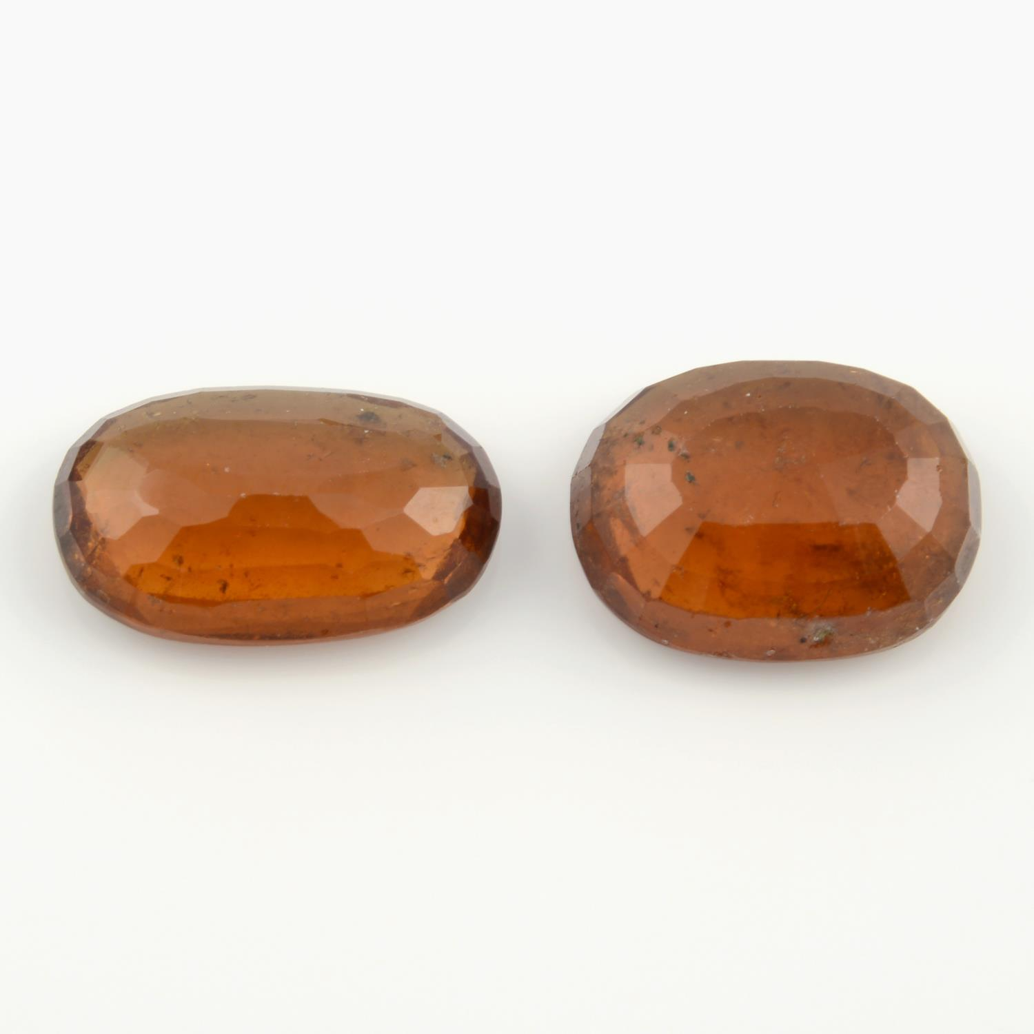 Three oval shape hessonite garnets, weighing 20.40ct, one within GLI seal. - Image 2 of 5