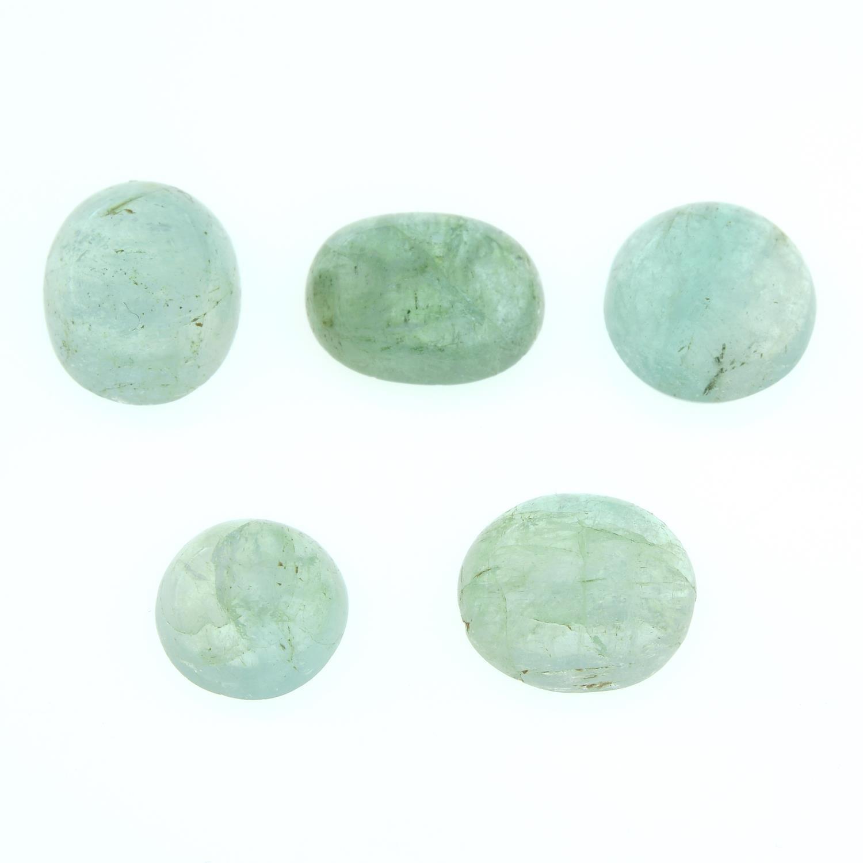 Five vari-shape emerald cabochons.