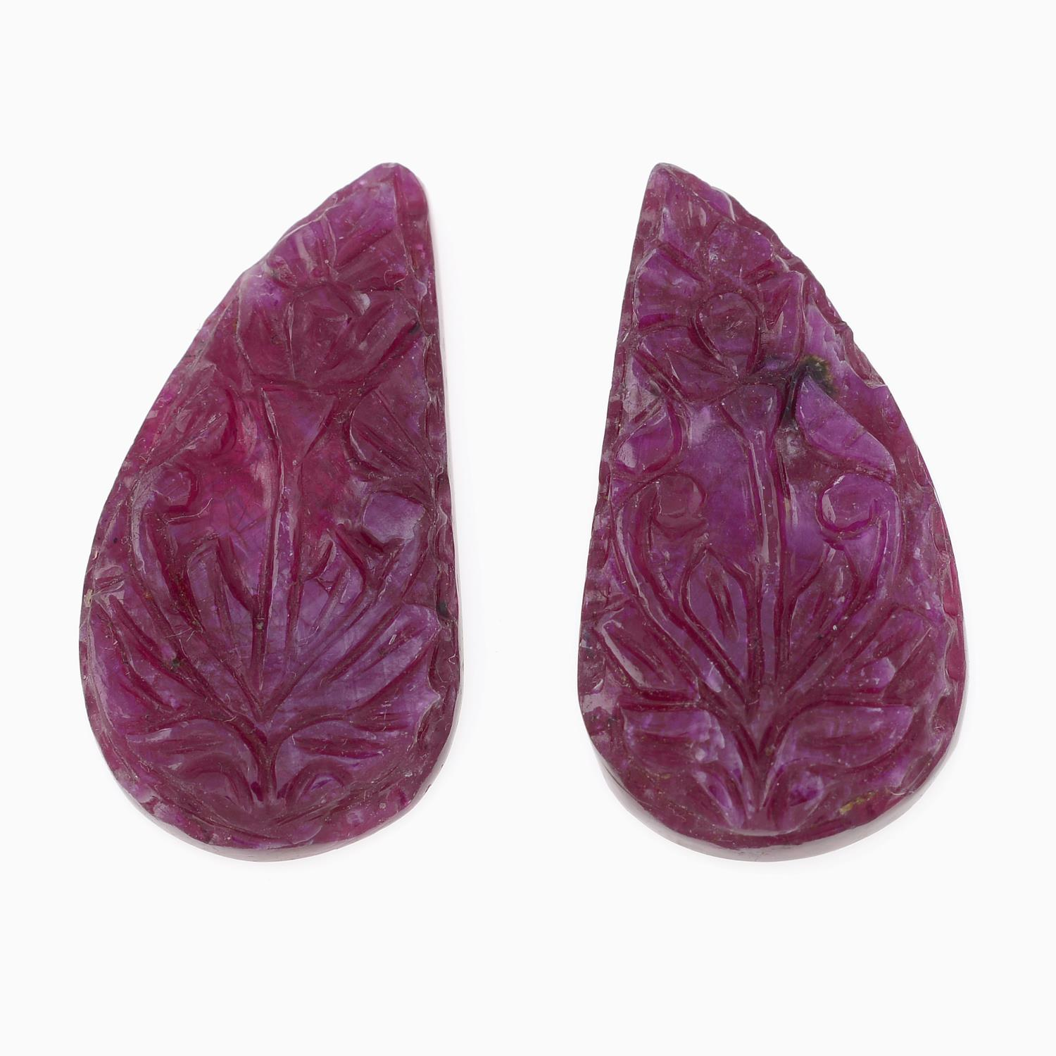 Selection of rough and carved rubies,