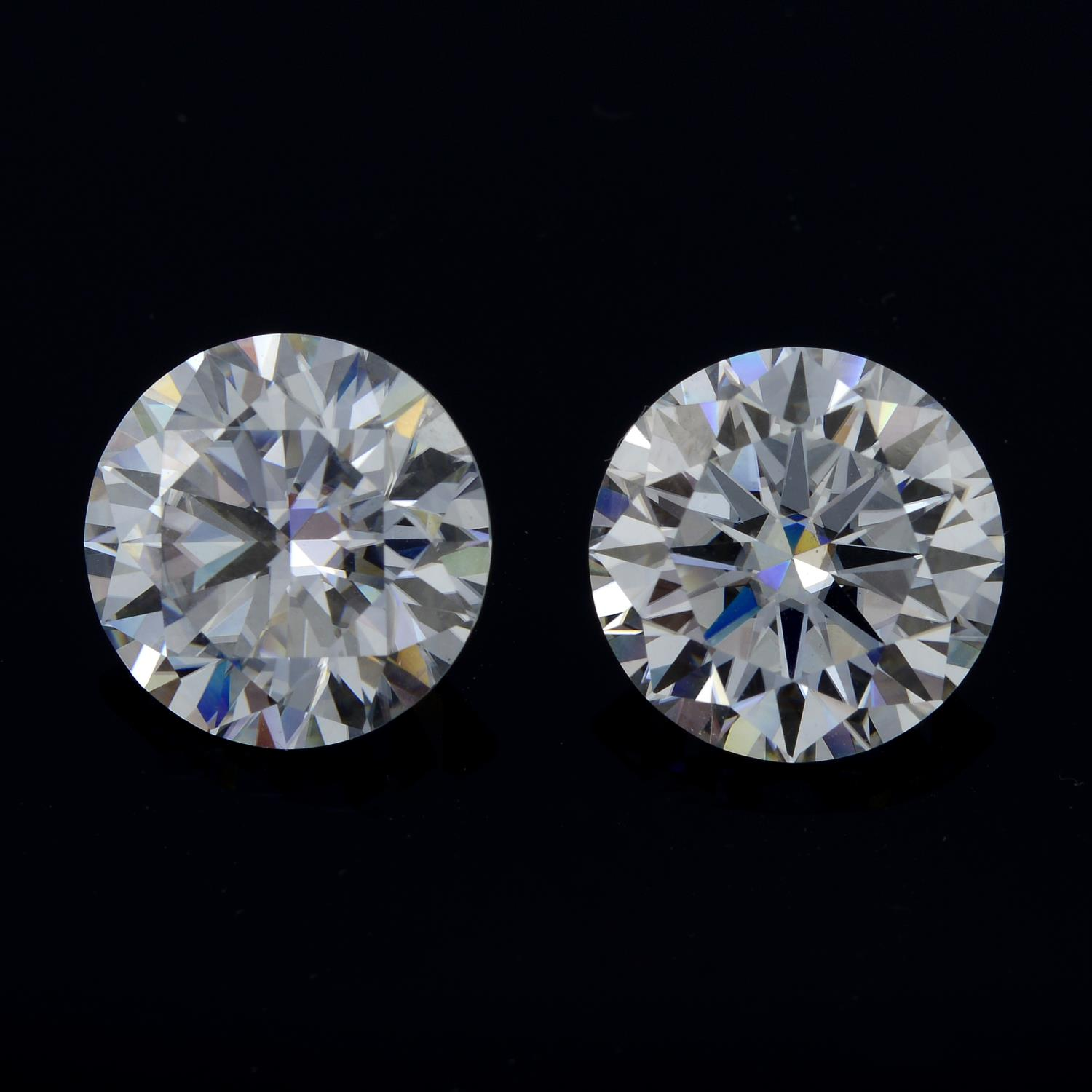 A pair of circular shape synthetic moissanite, weighing 7cts.