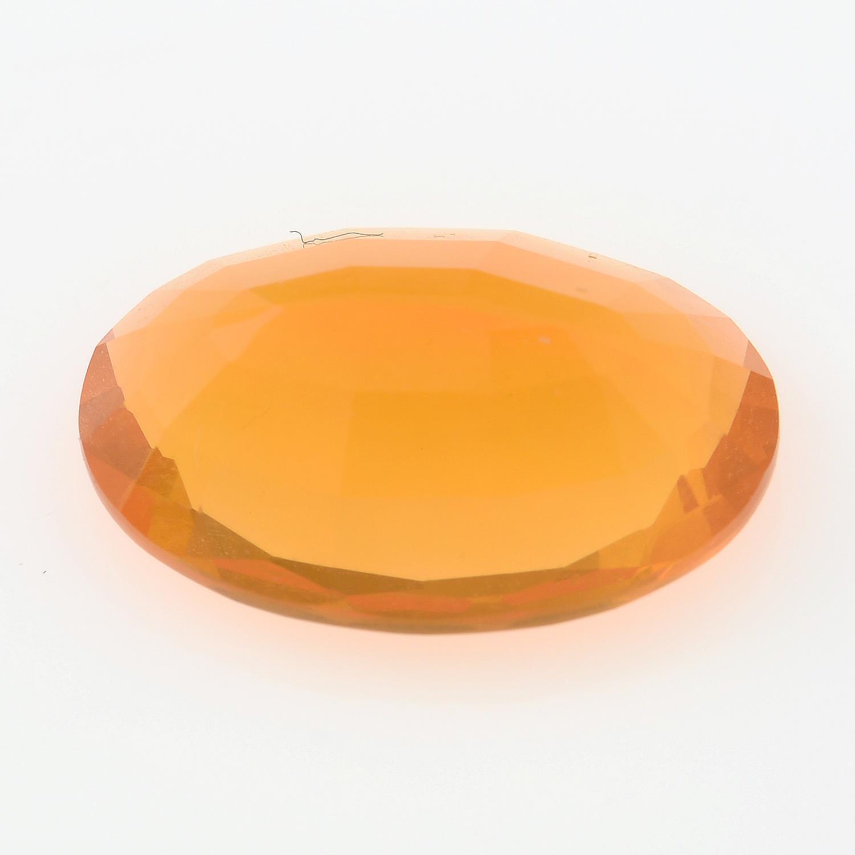 An oval-shape fire opal. - Image 2 of 2