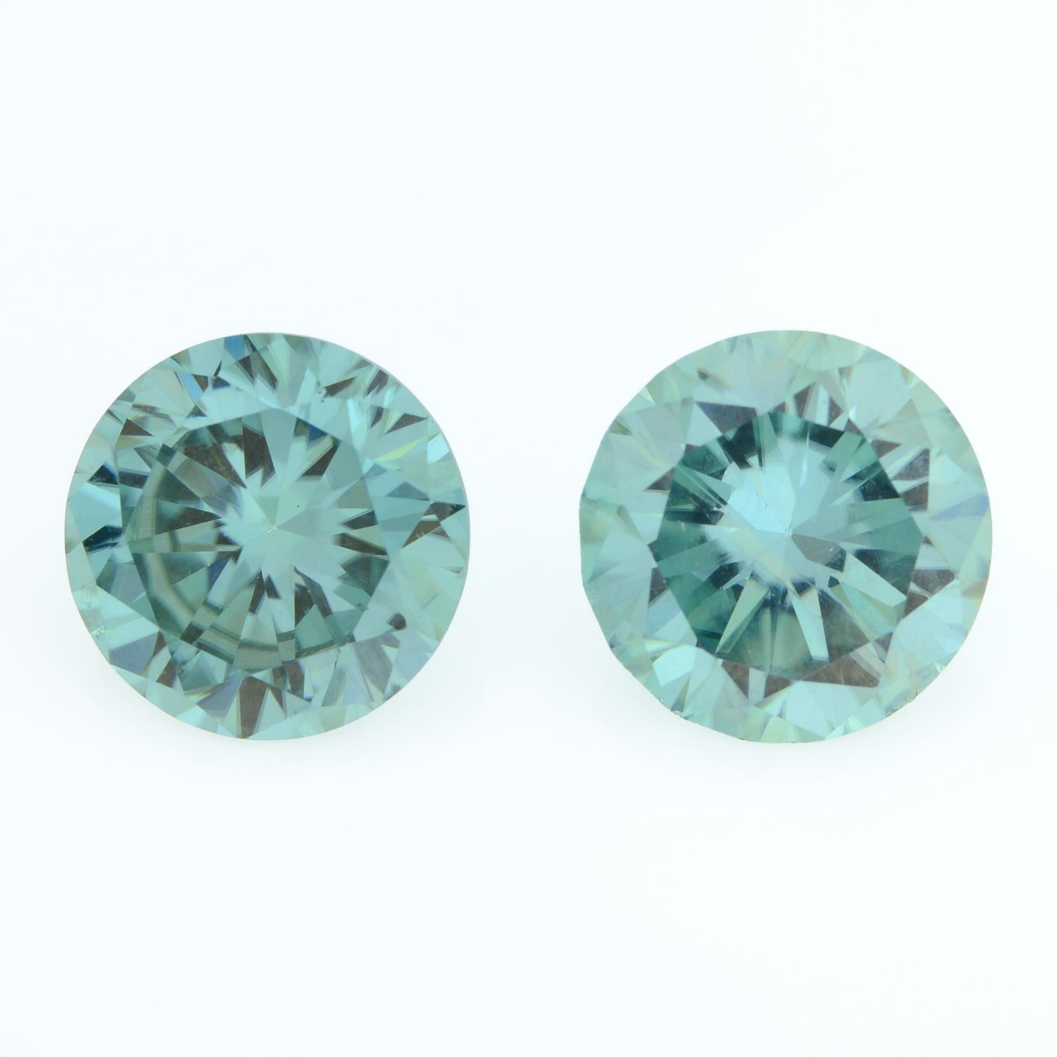 A pair of circular-shape green synthetic moissanite, total weight 6.48cts.