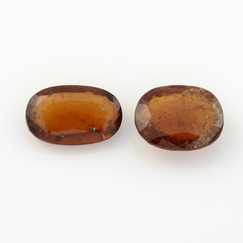 Three oval shape hessonite garnets, weighing 20.40ct, one within GLI seal.