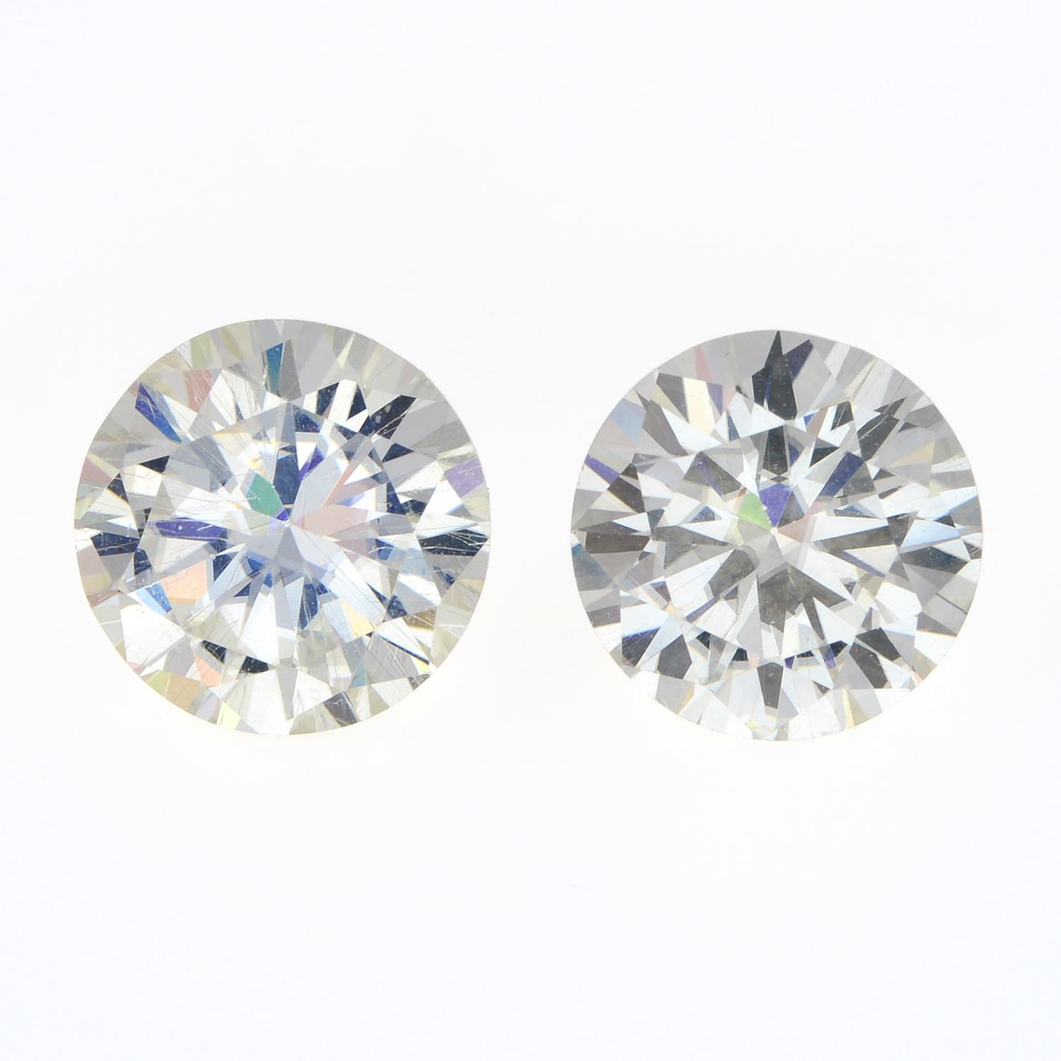 A pair of circular-shape synthetic moissanite, total weight 5.27cts.
