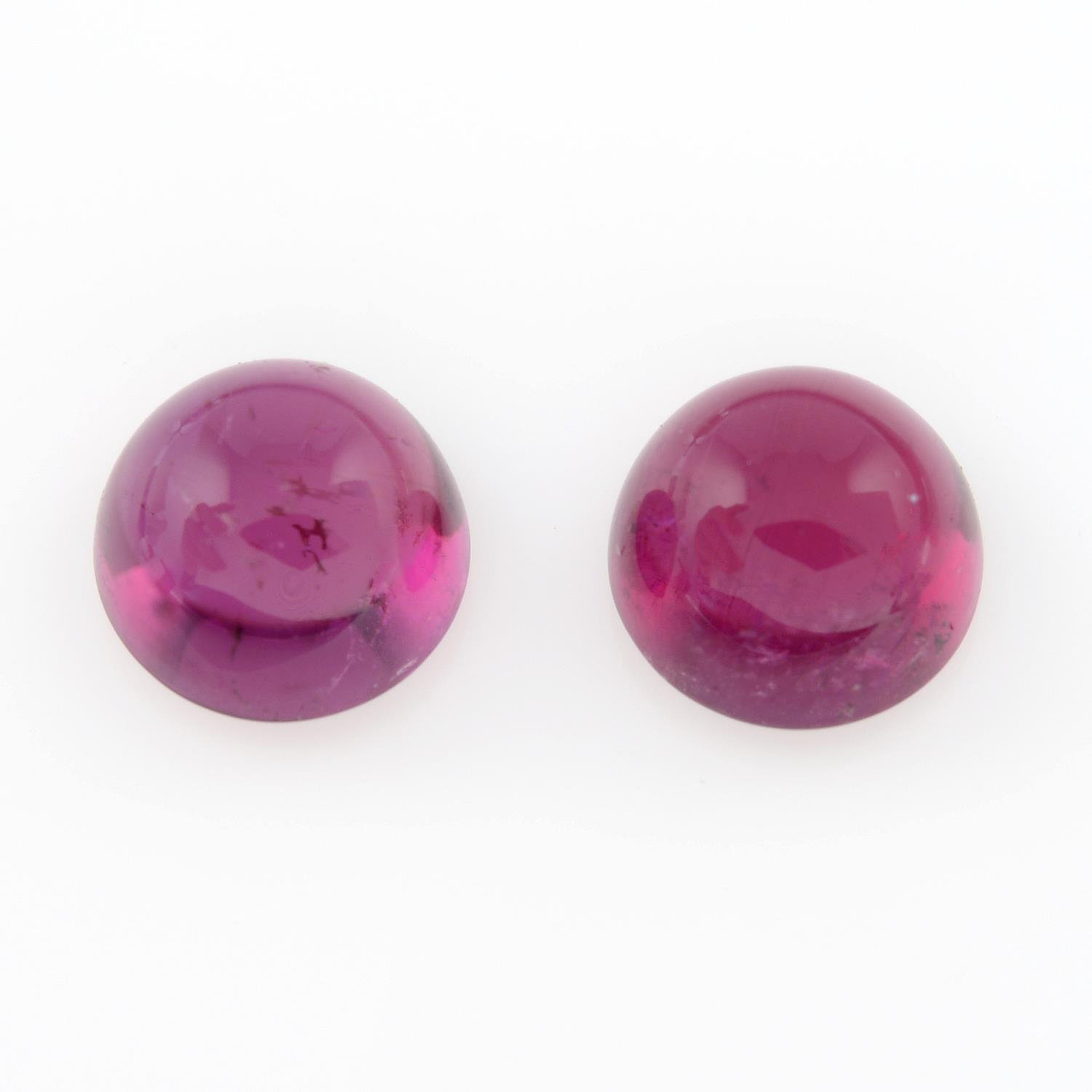 Pair of rubellite cabochons, weighing 3.66ct.
