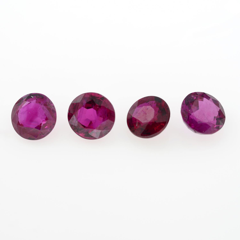 Four circular shape rubies, weighing 2.34ct.