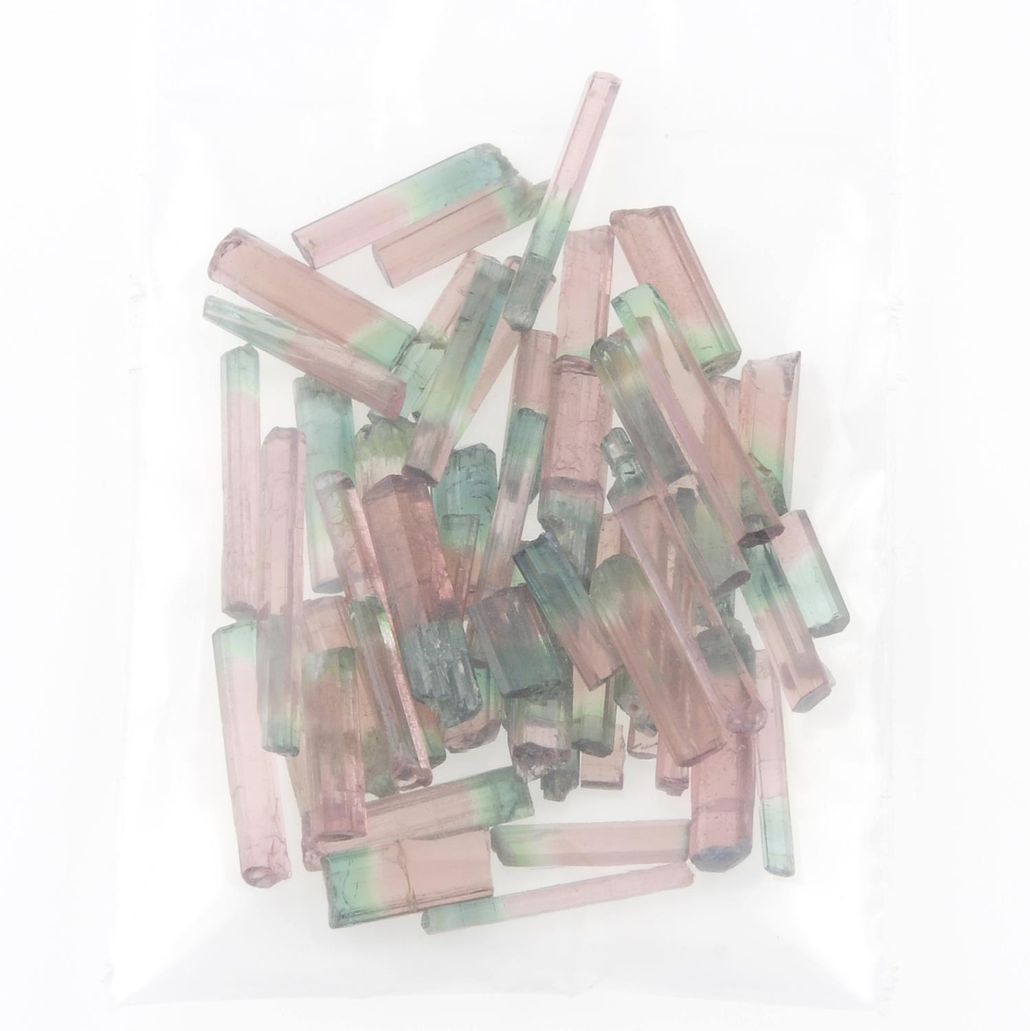 A selection of rough bi-colour tourmalines. - Image 2 of 2