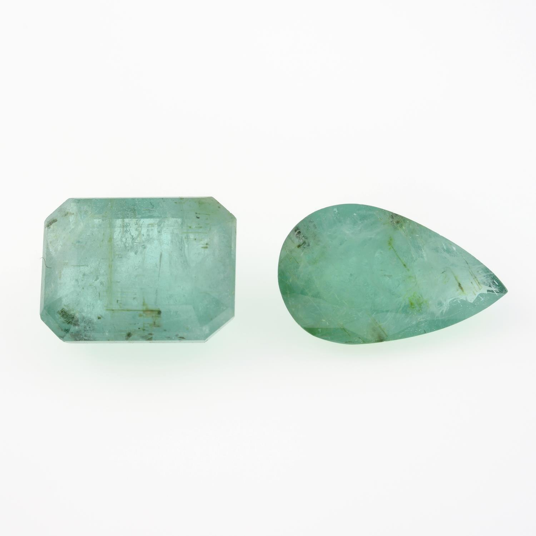 Two vari-shape emeralds, weighing 10.65ct.