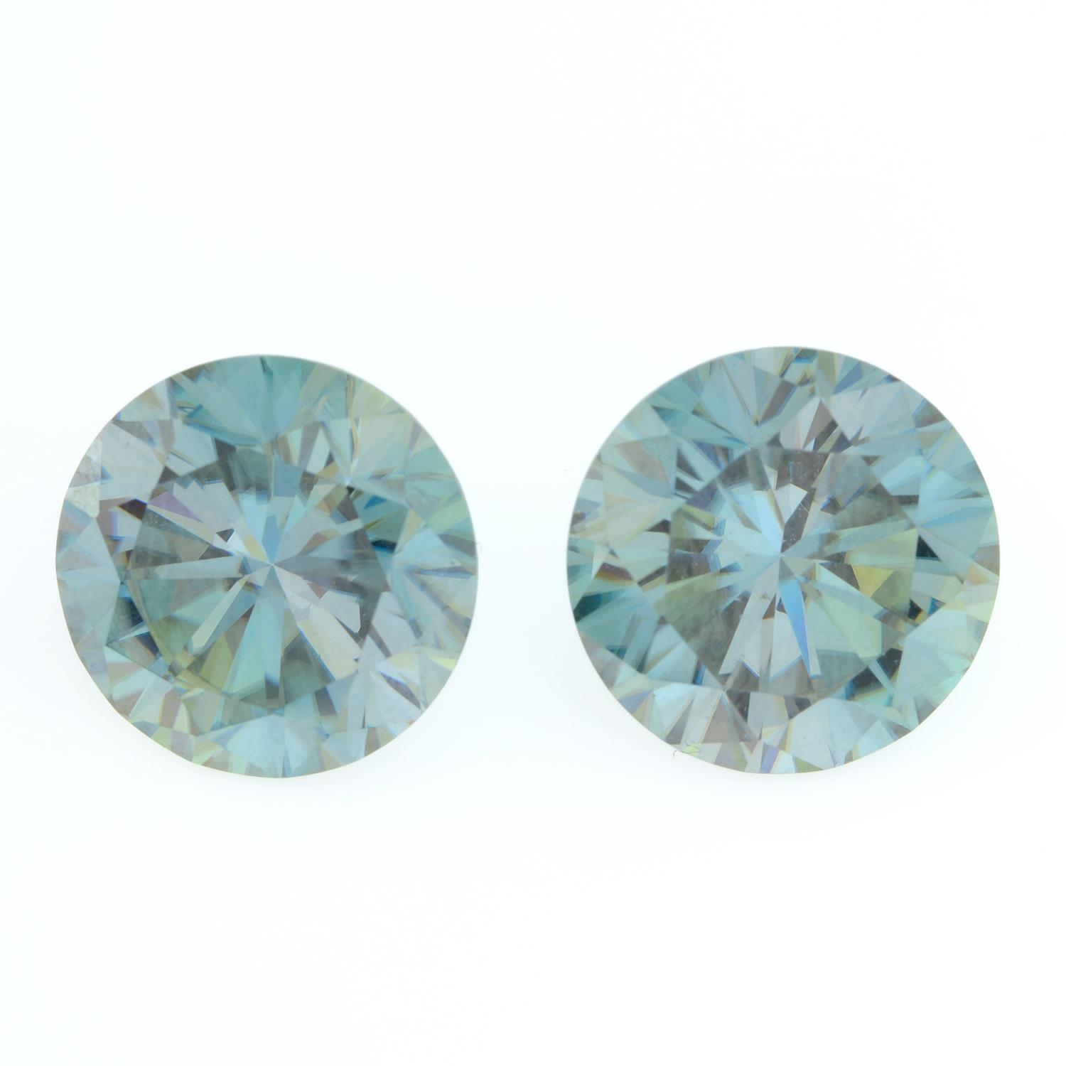 A pair of circular-shape green synthetic moissanite, weighing 13.72cts total.