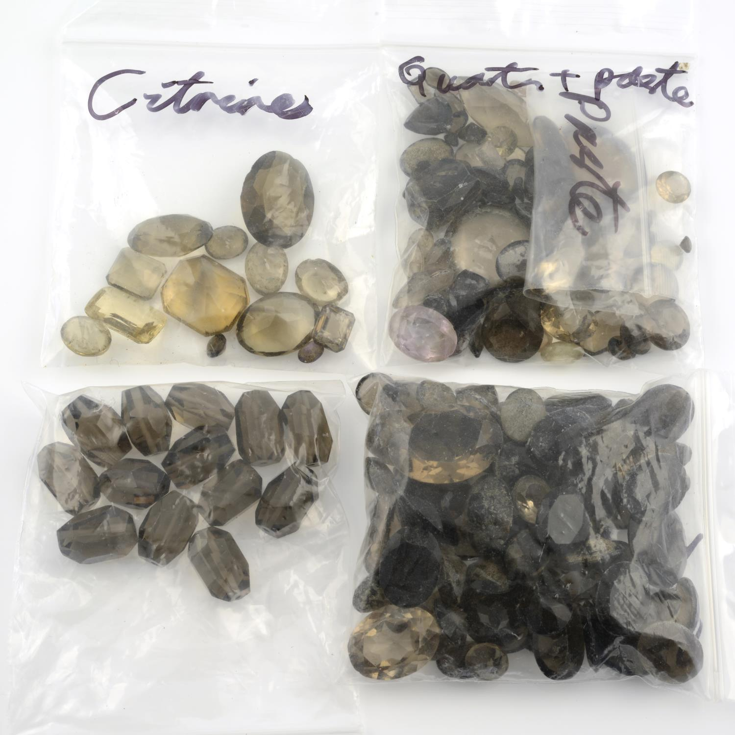 A selection of gemstones, to include predominantly smoky quartz, weighing 307gms. - Image 2 of 3