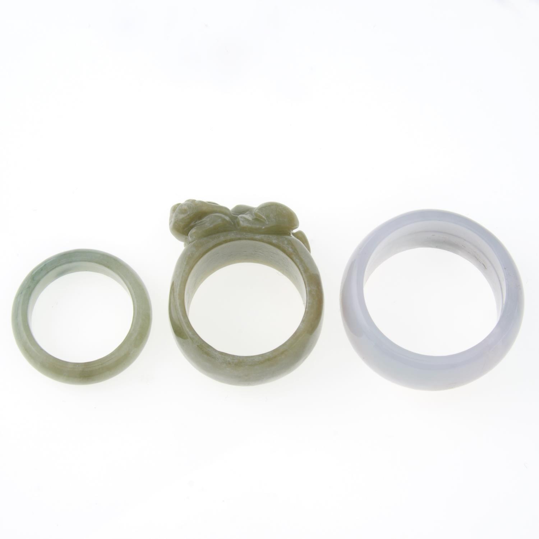 Two jade bangles and three jade rings,