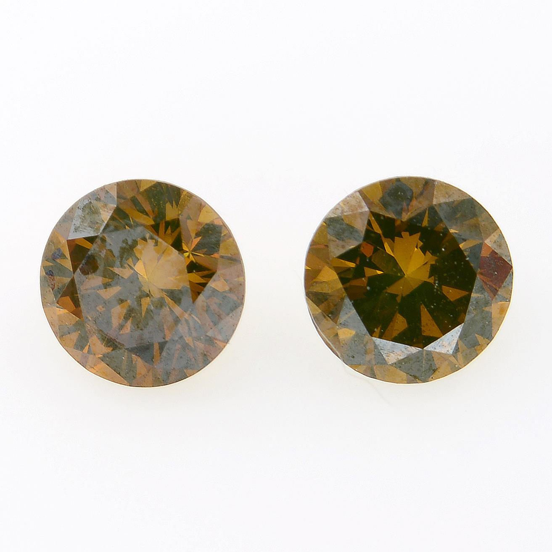 Pair of 'brown' diamonds, weighing 0.52ct total.
