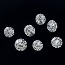 Seven brilliant-cut diamonds, weighing 0.84ct total.