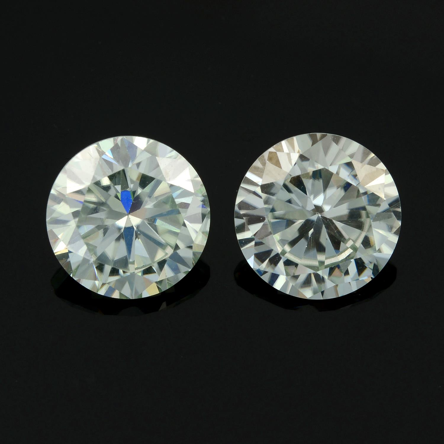 A pair of circular-shape colourless synthetic moissanite total weight 3.62cts.