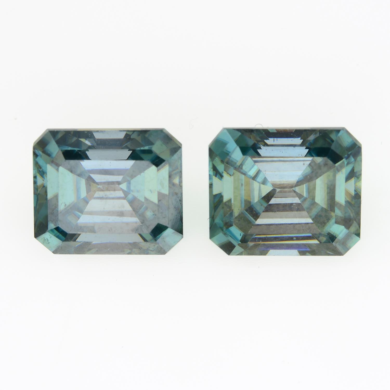 A pair of rectangular shape green moissanite.
