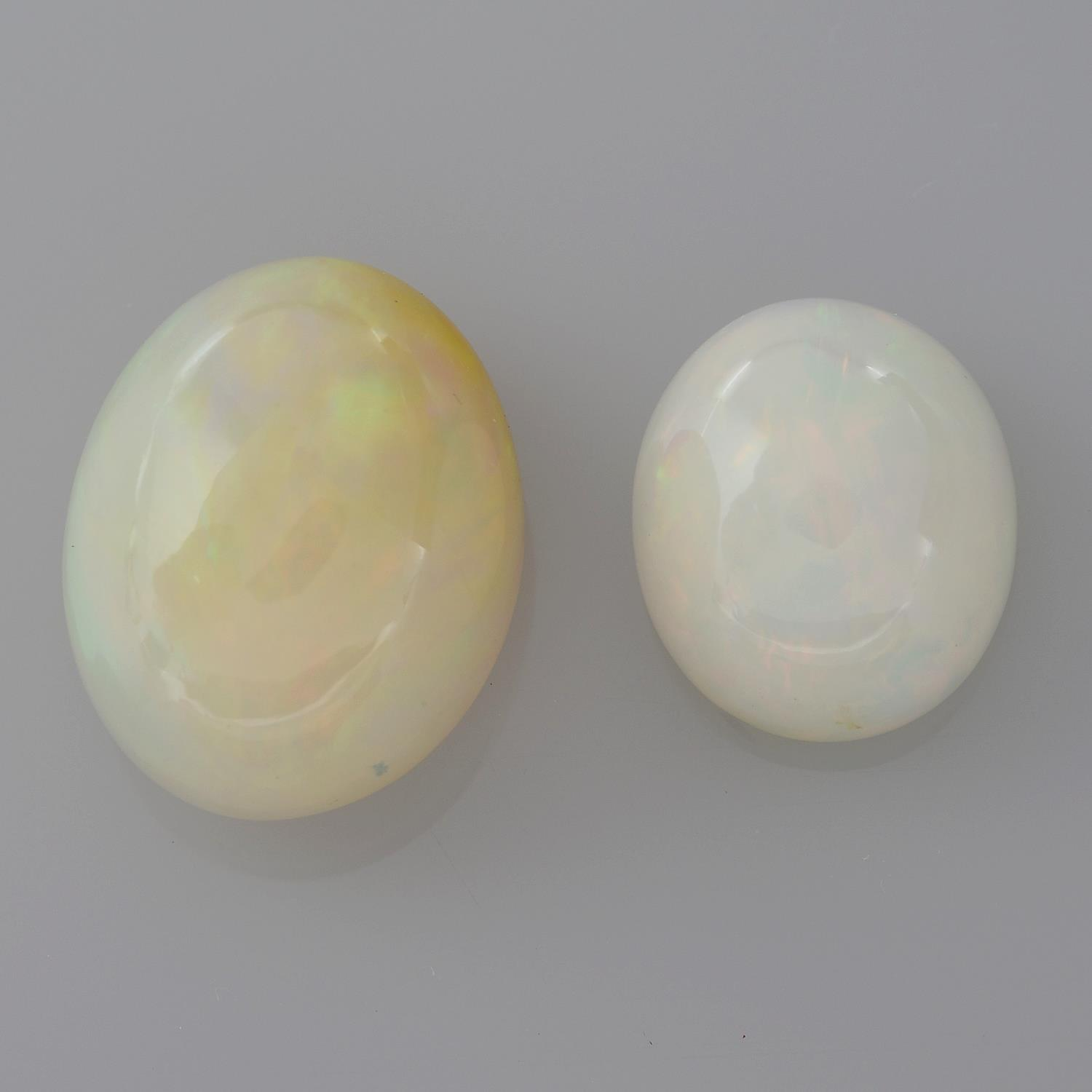 Two oval shape opals, weighing 11.15ct.