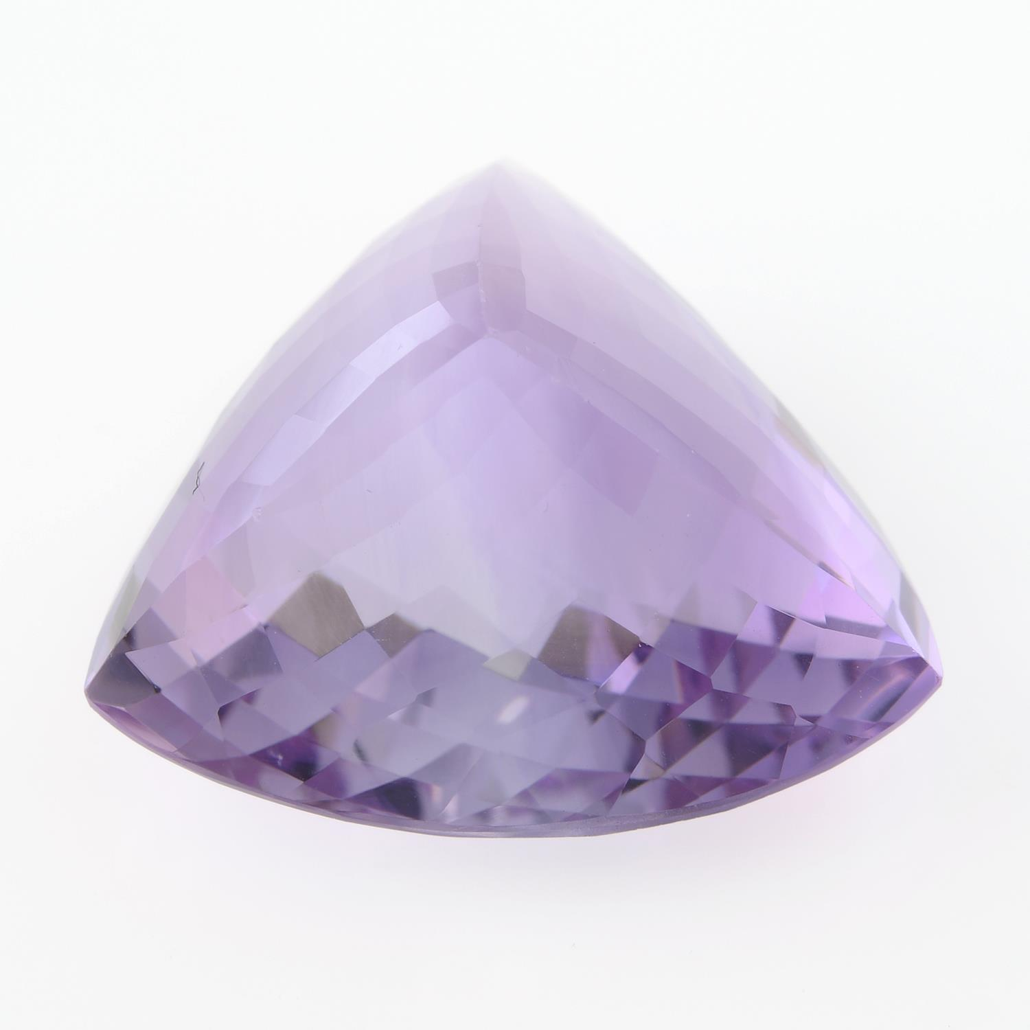 A triangular shape amethyst, weighing 28.47ct. - Image 2 of 2